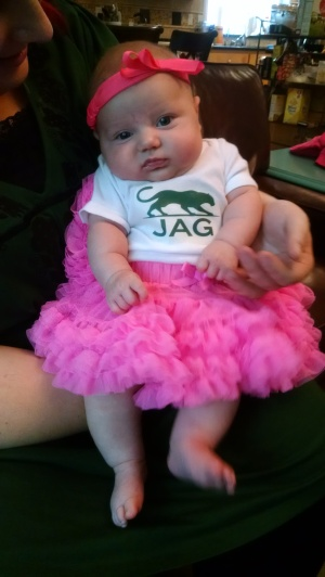 This is the face of someone not happy that her Auntie Sara made her wear this stupid pink tutu.